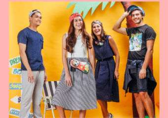 Two girls and two boys modeling casual clothes against a yellow backdrop