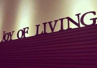 The Joy of Living Cafe logo