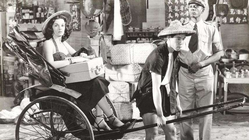 Woman being carried in a cart by a Macanese in old Macau days