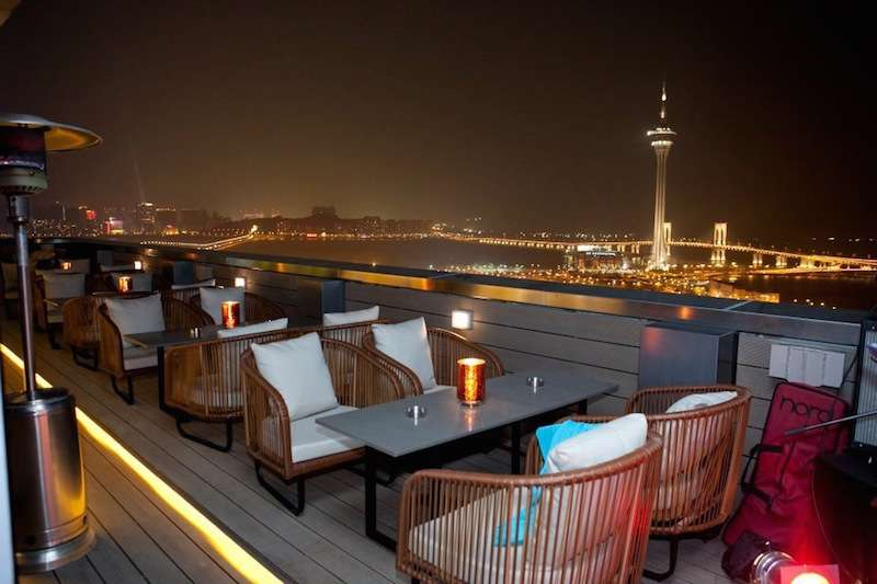 Outdoor seating area at Sky 21 bar and restaurant in Macau