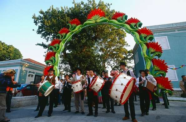 19th Lusofonia Festival- men with instruments outside playing music in Macau