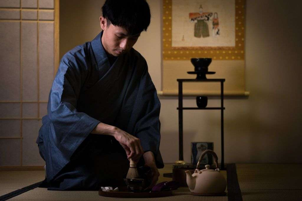 Japanese man in yukata preparing tea