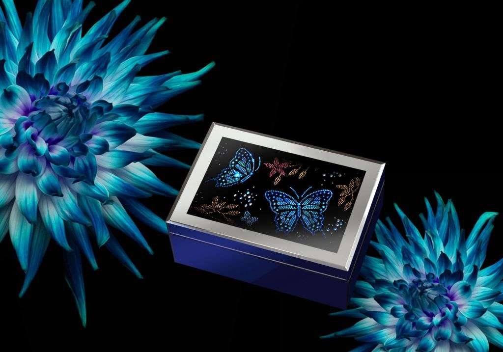 02 The butterfly symbolizes liveliness and happiness and is represented by the dazzling cobalt blue and rose studs.