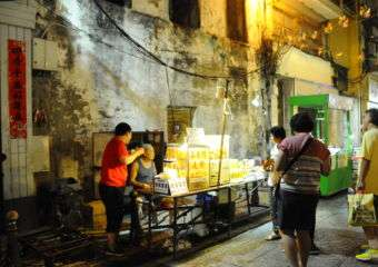 Customers gathered around a stall at the night market in Macau