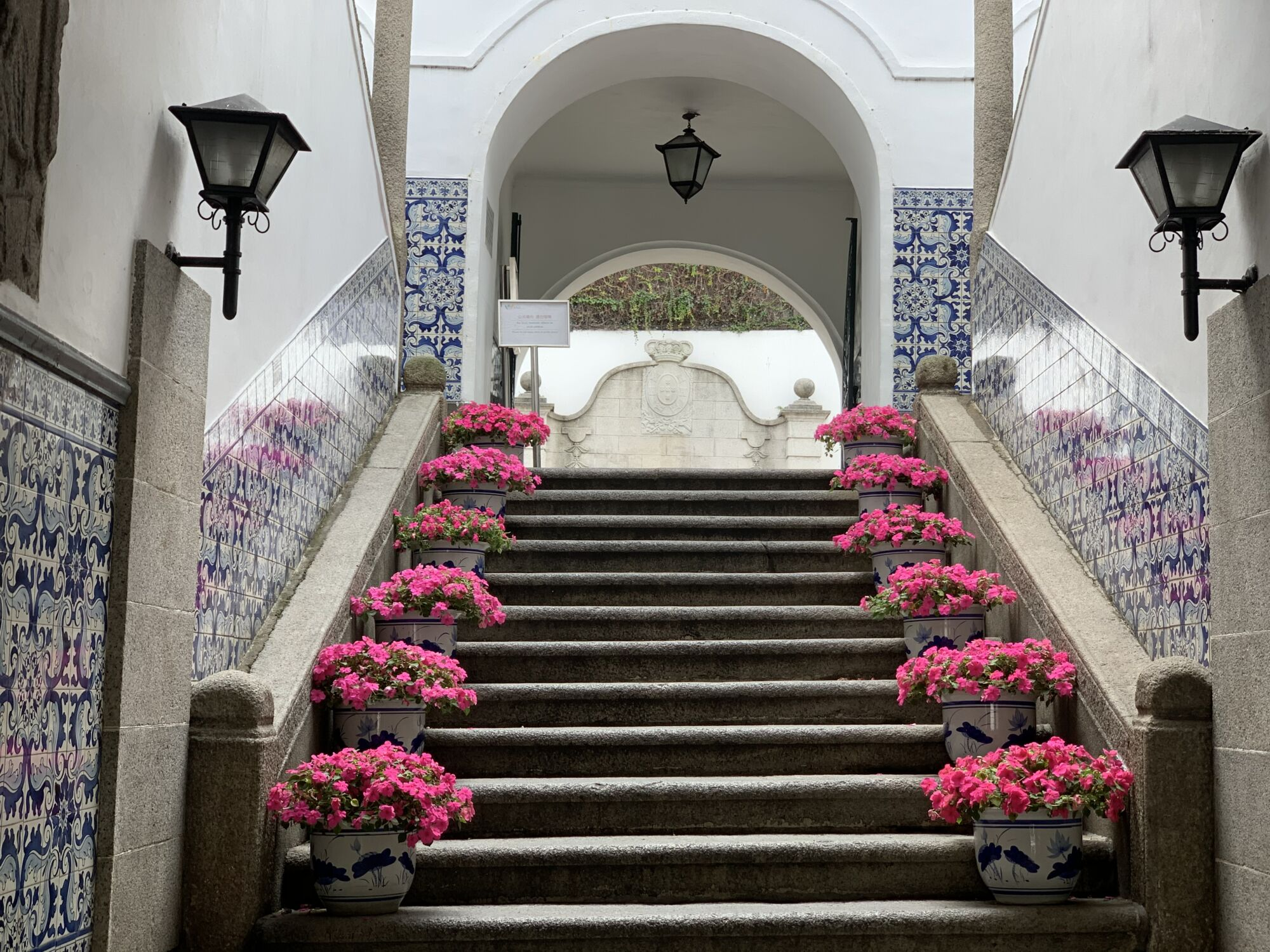Leal Senado Building Entrance with Pink Flowers View from Below Macau Lifestyle