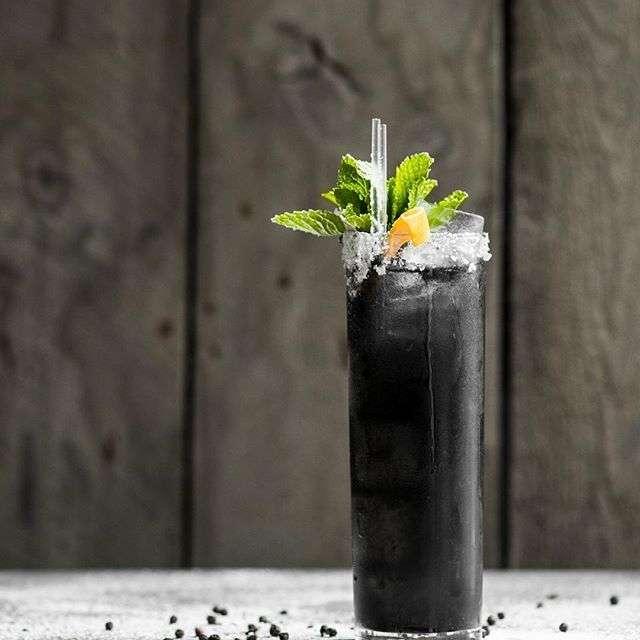 A dark-colored cocktail at Aurora, Altira Hotel, Macau