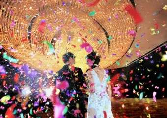 A bride and groom at wedding party in Mandarin Oriental Macau.