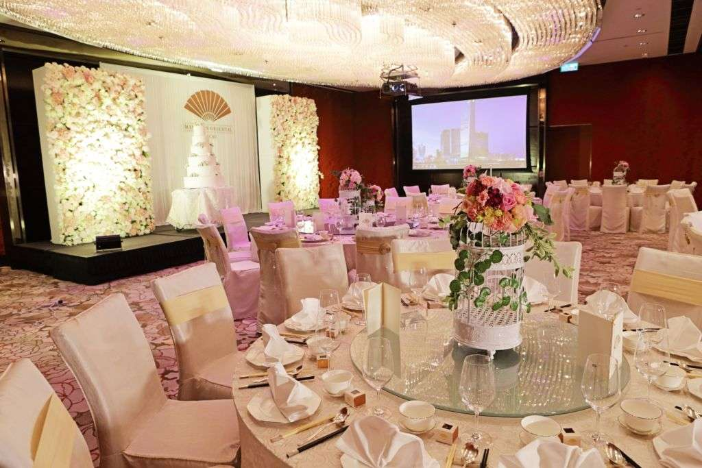 Light-colored wedding party table settings at Mandarin Oriental Macau.