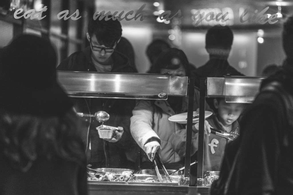 Black and white image of people in a buffet