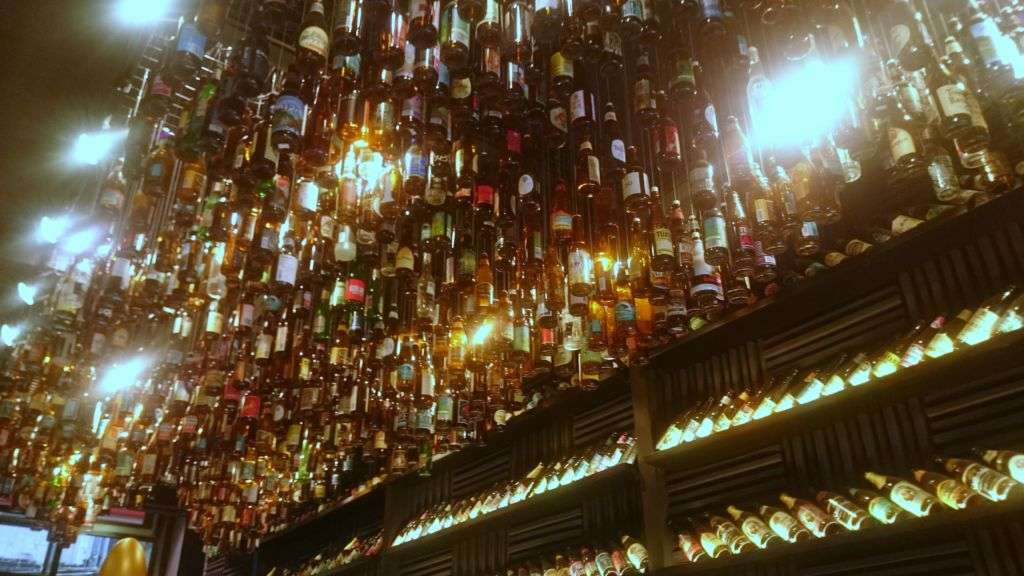 Craft beer bottles hanging on the ceiling