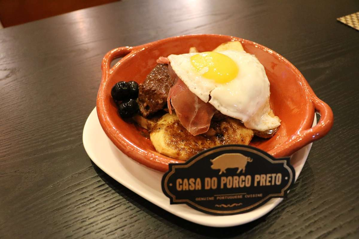 Classic Portuguese steak dish on a table.