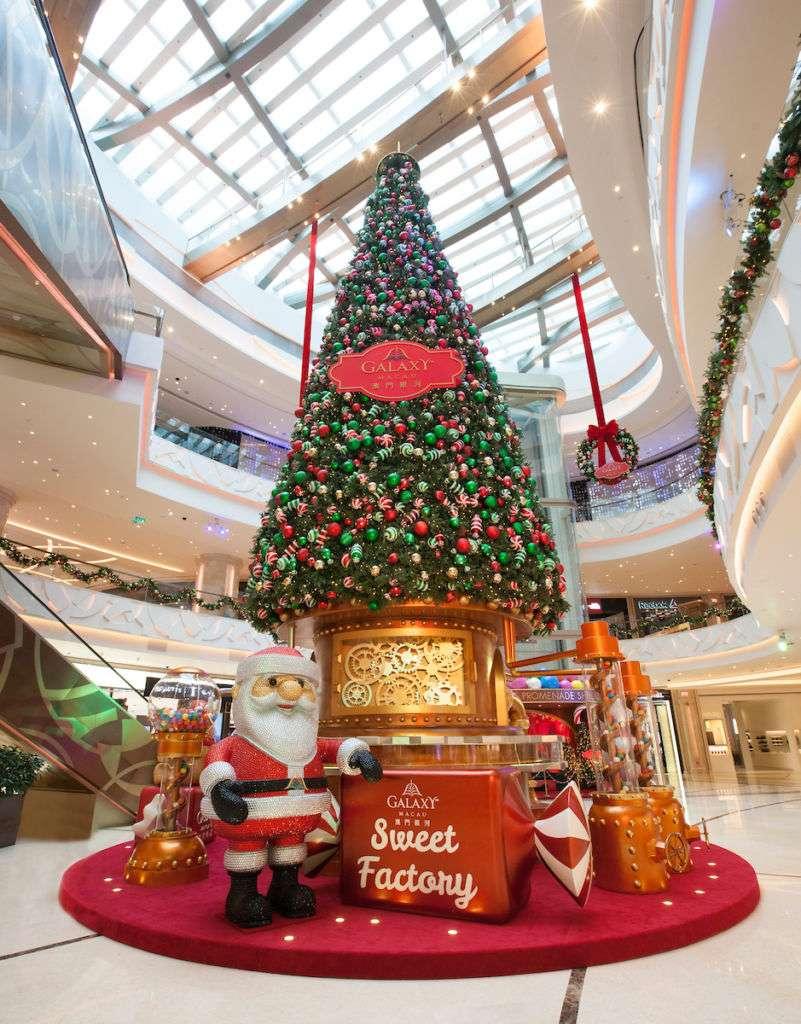 A giant Christmas tree and Santa Claus decoration at Galaxy Macau.