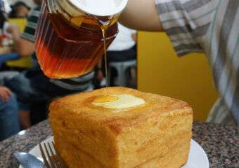 Syrup being poured on top of a french toast