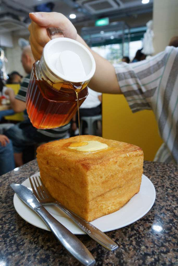 food cha chaan teng macau Syrup being poured on top of a french toast