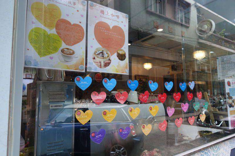 Coffee shop window with heart shaped stickers