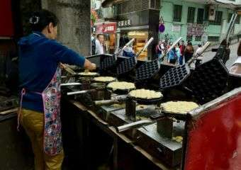 Woman making street waffles