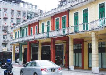 Exterior of the Patane Library in western Macau, displaying the classical arcade architectural style.