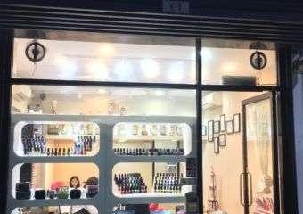 Exterior at night of Ruby Nail beauty salon in Macau.