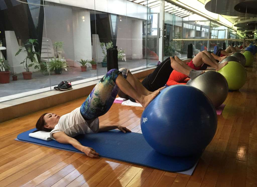 A group of people doing pilates