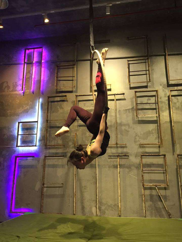 Woman upside down on aerial hoop at Macau design centre