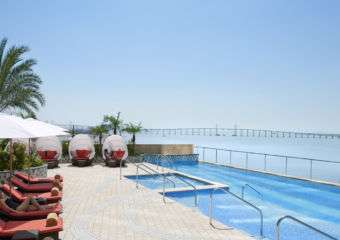 Pool at Mandarin Oriental Macau in the sun pool days by mo macau events august