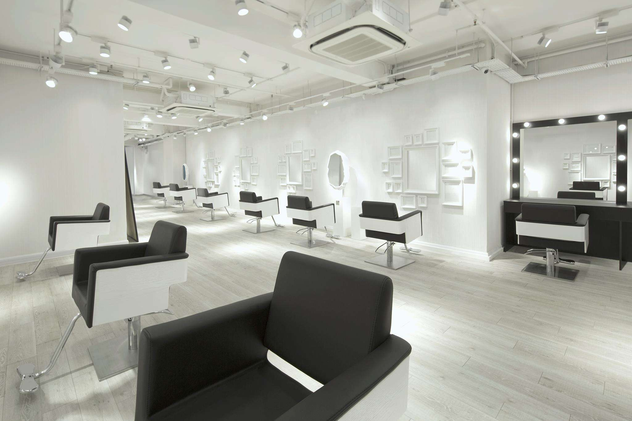 All white hair salon with black and white chairs