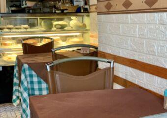utama restaurant corner table