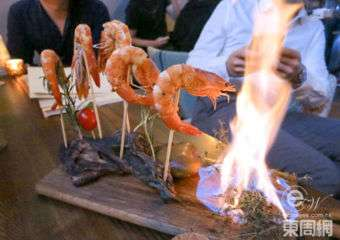 Wolfpack prawn dish on fire, at Wolfpack restaurant in Macau.