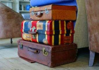 Suitcases stacked on top of each other