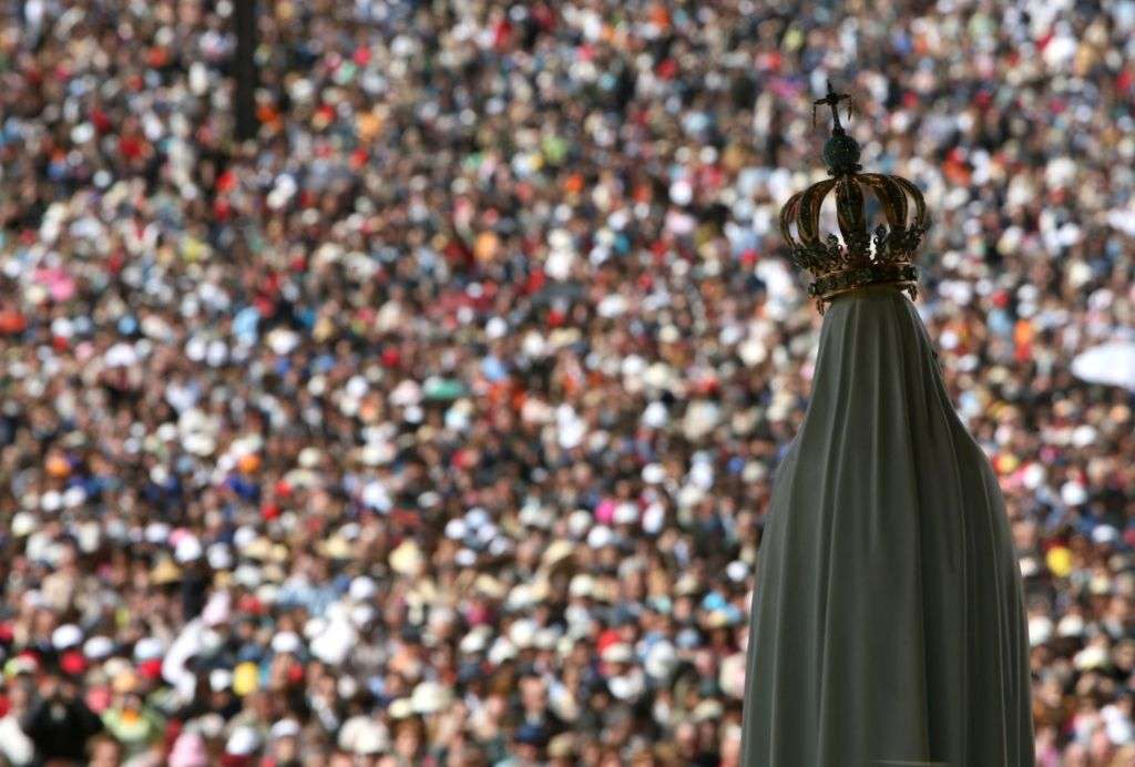 The statue of Our Lady of Fatima overlooks worshipers at the Fatima shrine