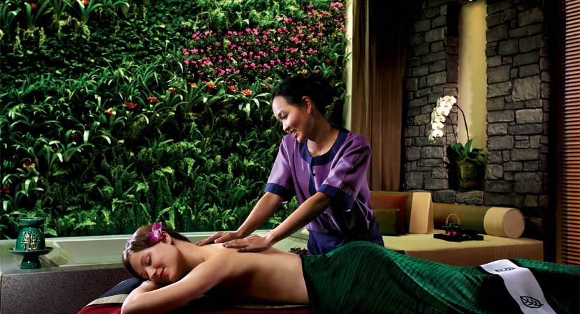 Woman receiving massage at Banyan Tree spa in Macau.