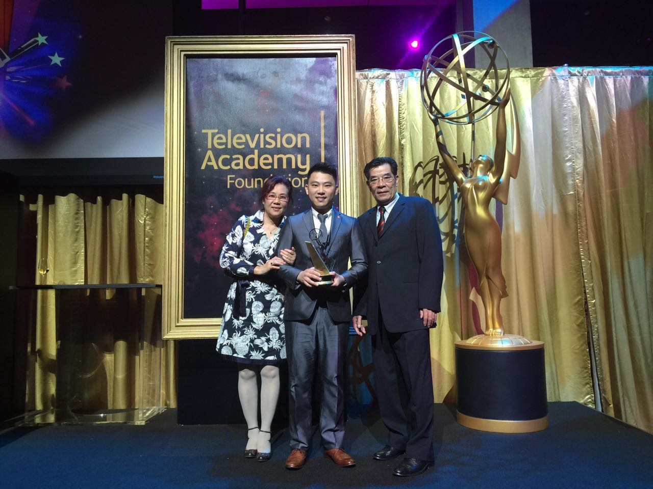 Filmmaker Cheok Lei posing with his award at the Television Academy