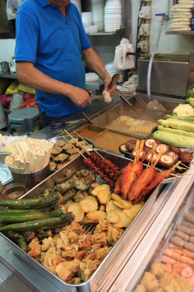 An array of food items available from a fishball stall in Macau.