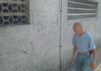 Man walking at the side street off Istmo de Ferreira do Amaral