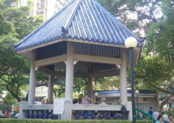 Musicians playing Cantonese folk music at the gazebo in Triangle Park in Macau's northern border district.