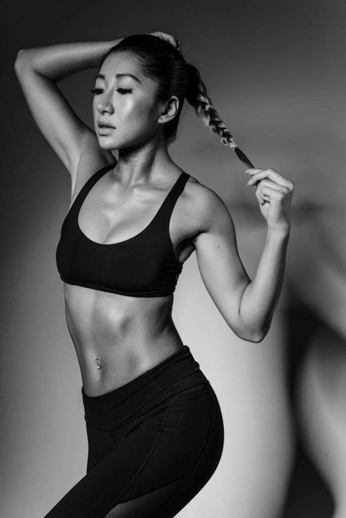 Ceci Lam black and white photo posing