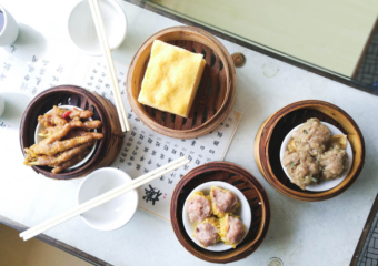 Four different dim sum baskets laid out on table in Long Wah teahouse in Macau.