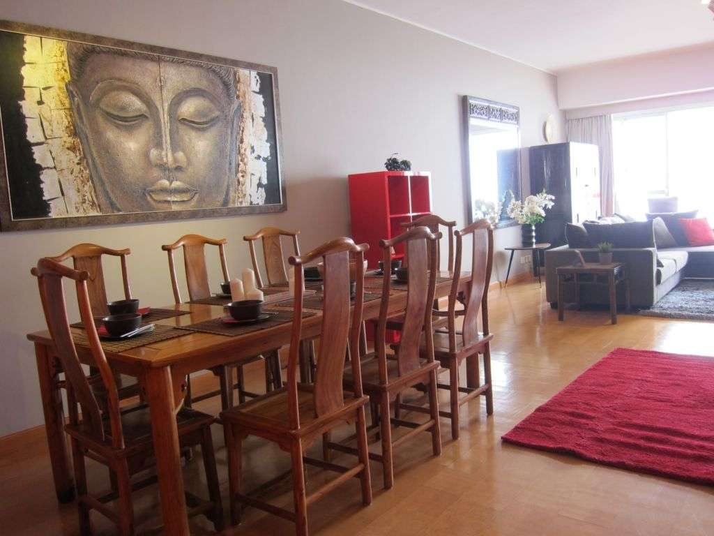 Living room with a dining table and Budda image on the wall buying property macau