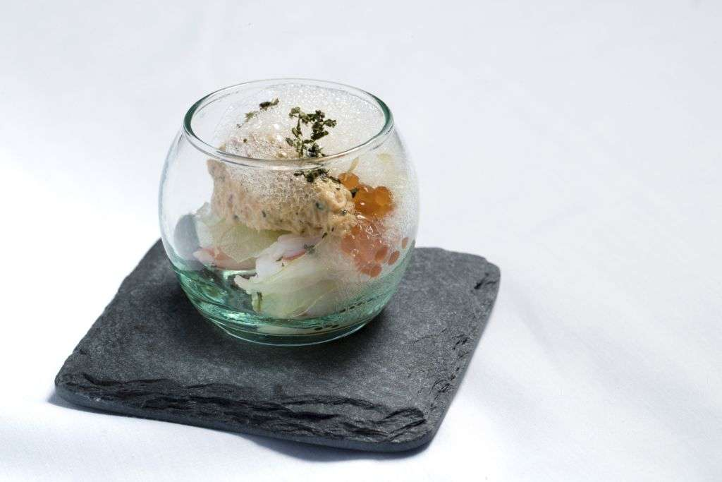 A dish of laksa-crab remoulade with kaffir lime air