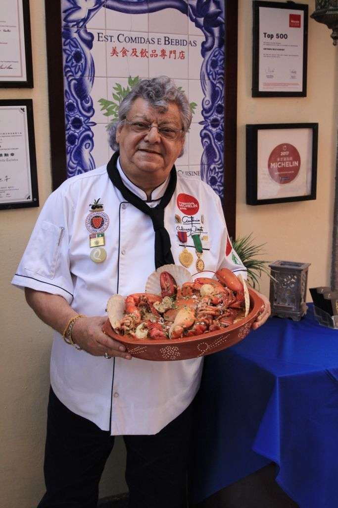 Chef Antonio holding a dish from his restaurant in Macau.