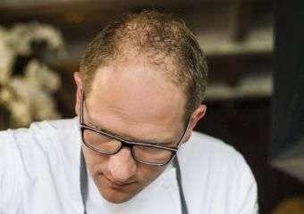Chef Rolf Fliegauf plating a dish.