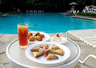 Small bites and a drink poolside at Flamingo restaurant in Regency Art Hotel in Macau