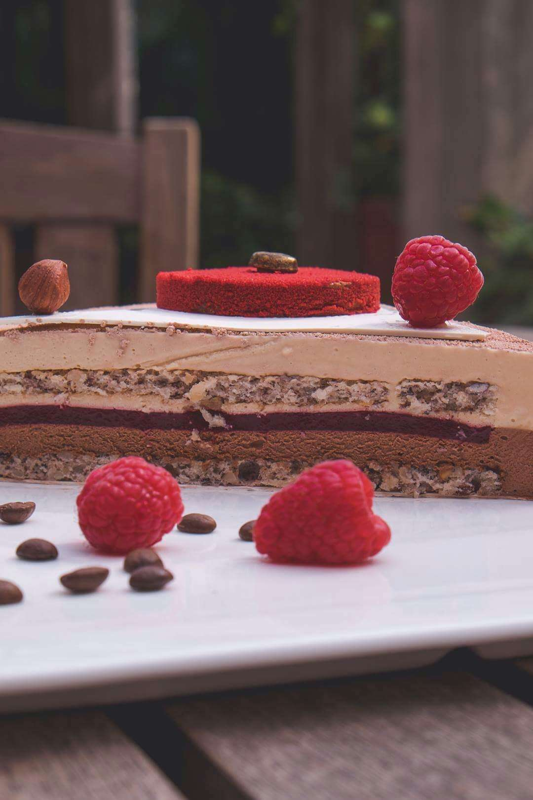 Closeup showing the layers of Grand Lapa's hazelnut coffee and chocolate raspberry layer cake