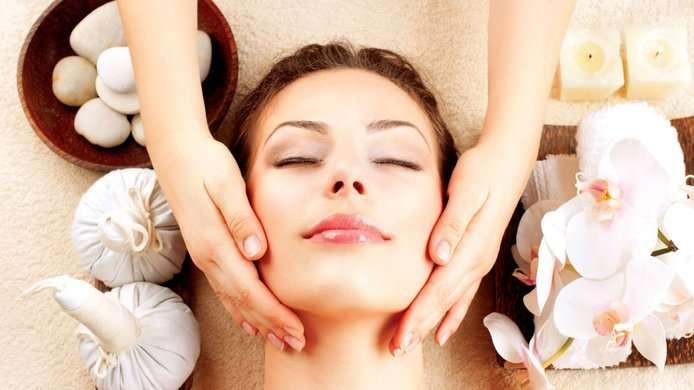 A woman receives a face massage.