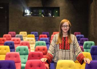 Cinematheque COO Rita Wong standing in their theater
