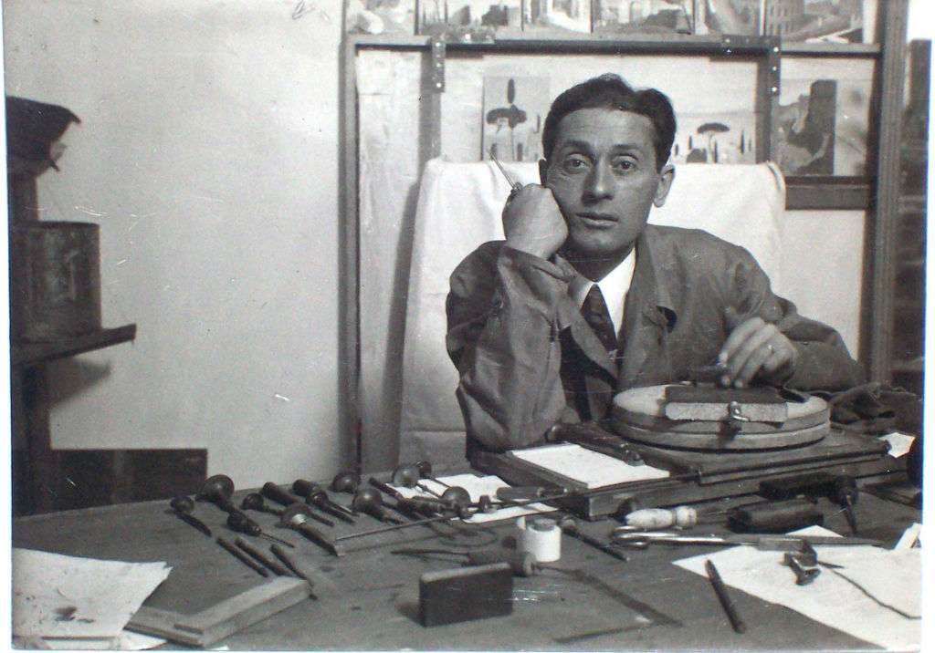 A man at a workbench with tools.