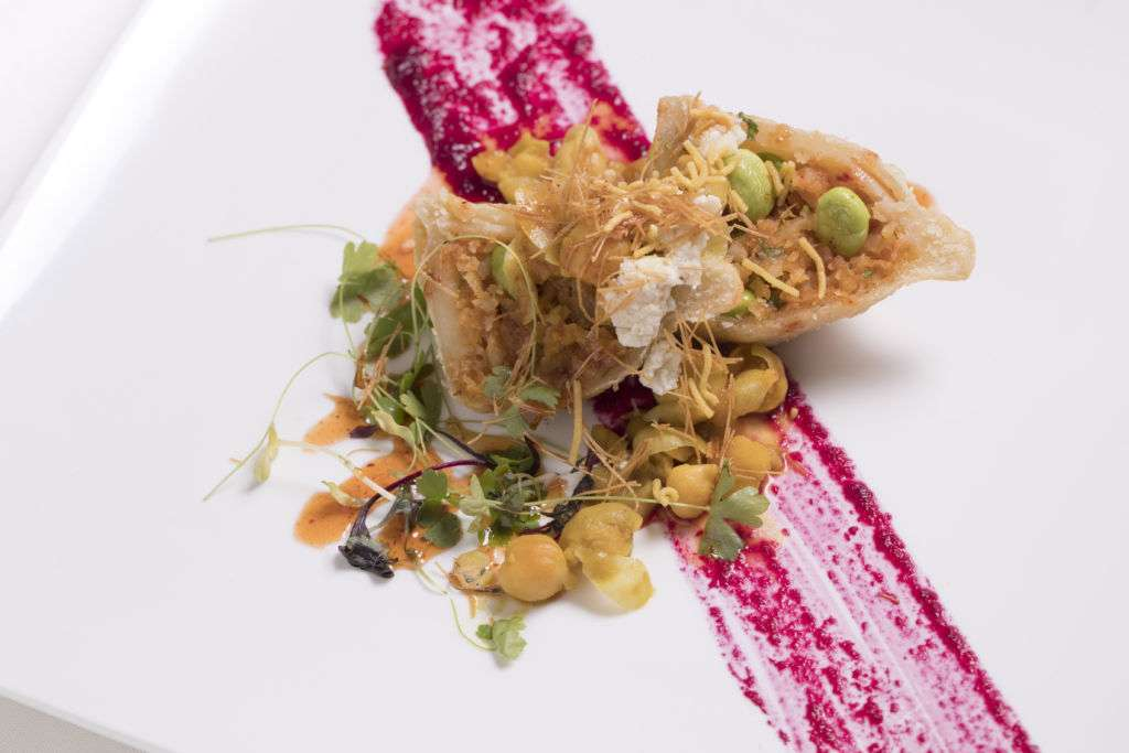 Song of India's head chef Manjunath Mural's samosa garbanzo goat cheese chat with tamarind mango spice drizzle.