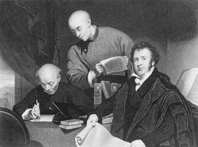 Robert Morrison at table with two other men.