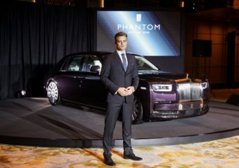 Rolls Royce Asia representative Ian Grant standing in front of a Rolls Royce automobile