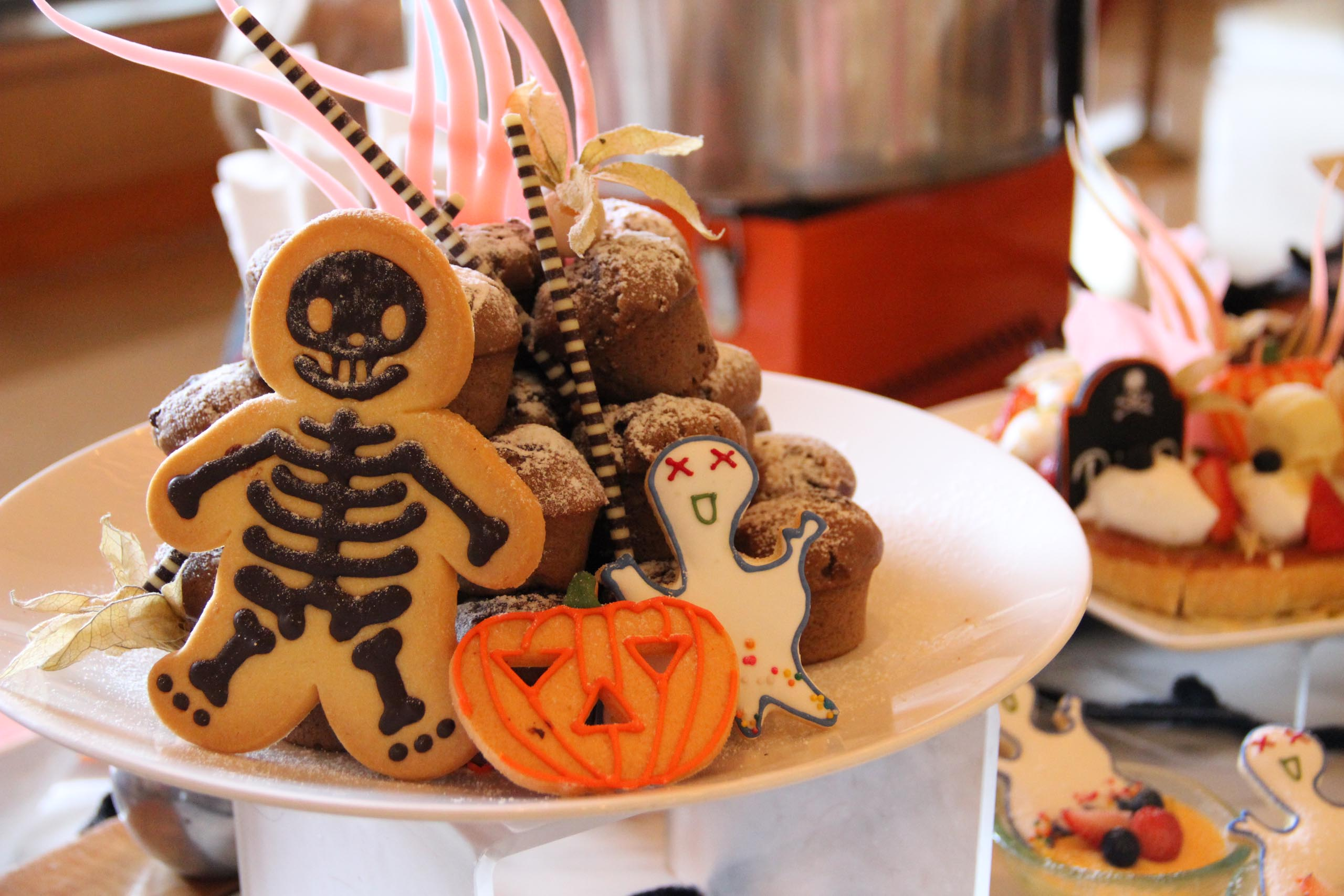 A plate of Halloween cookies and other desserts.